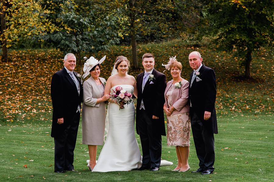 Family having their photo taken at a wedding