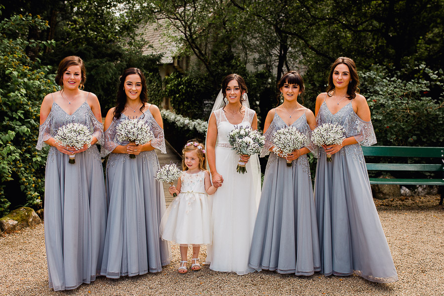 bride having a group photo taken with her bridesmaids