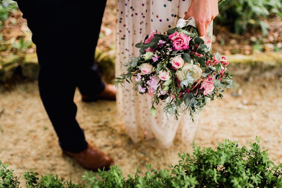 bride holding beautiful wedding flowers
