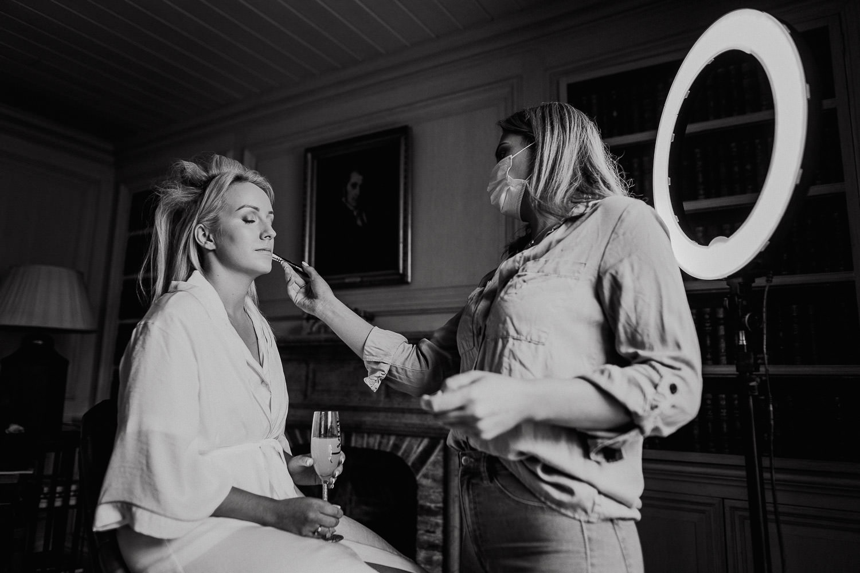 bride having her makeup done at Cliff at Lyons