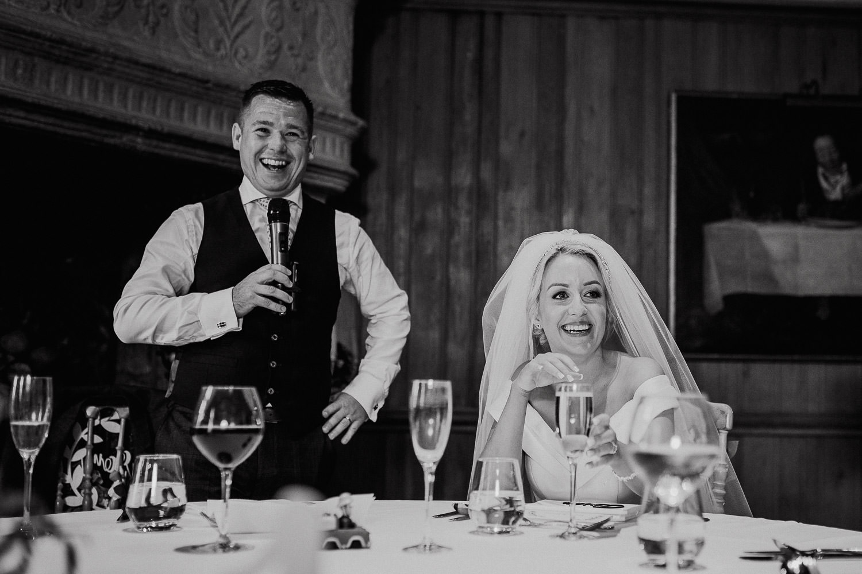 groom smiling making a wedding speech