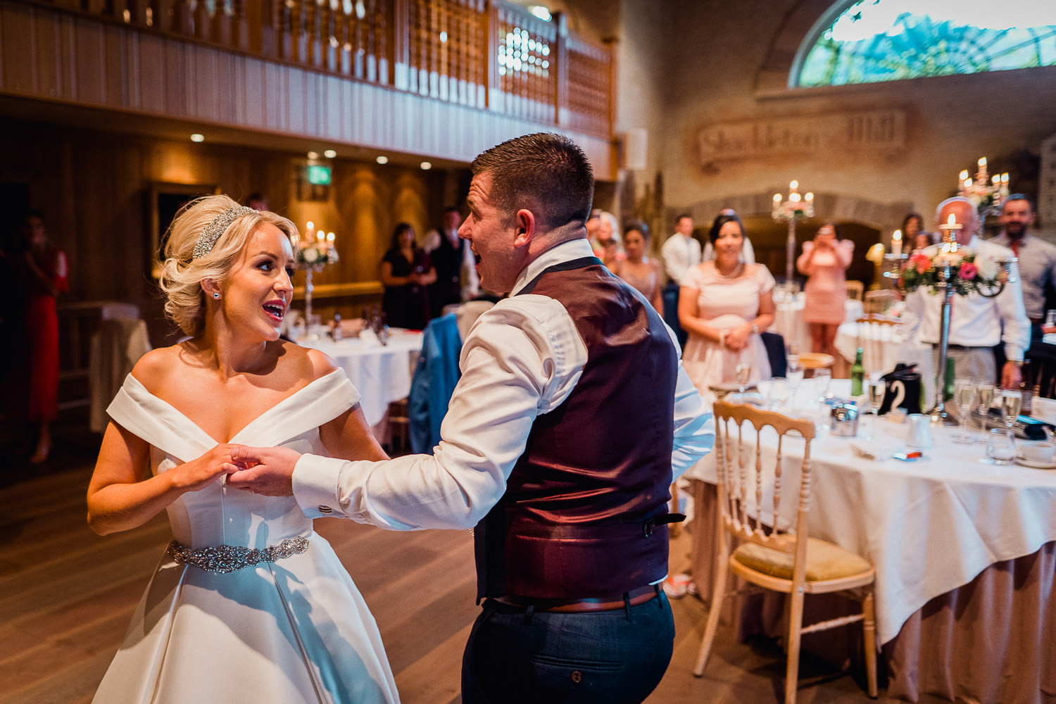 bride and groom dancing with wedding guests