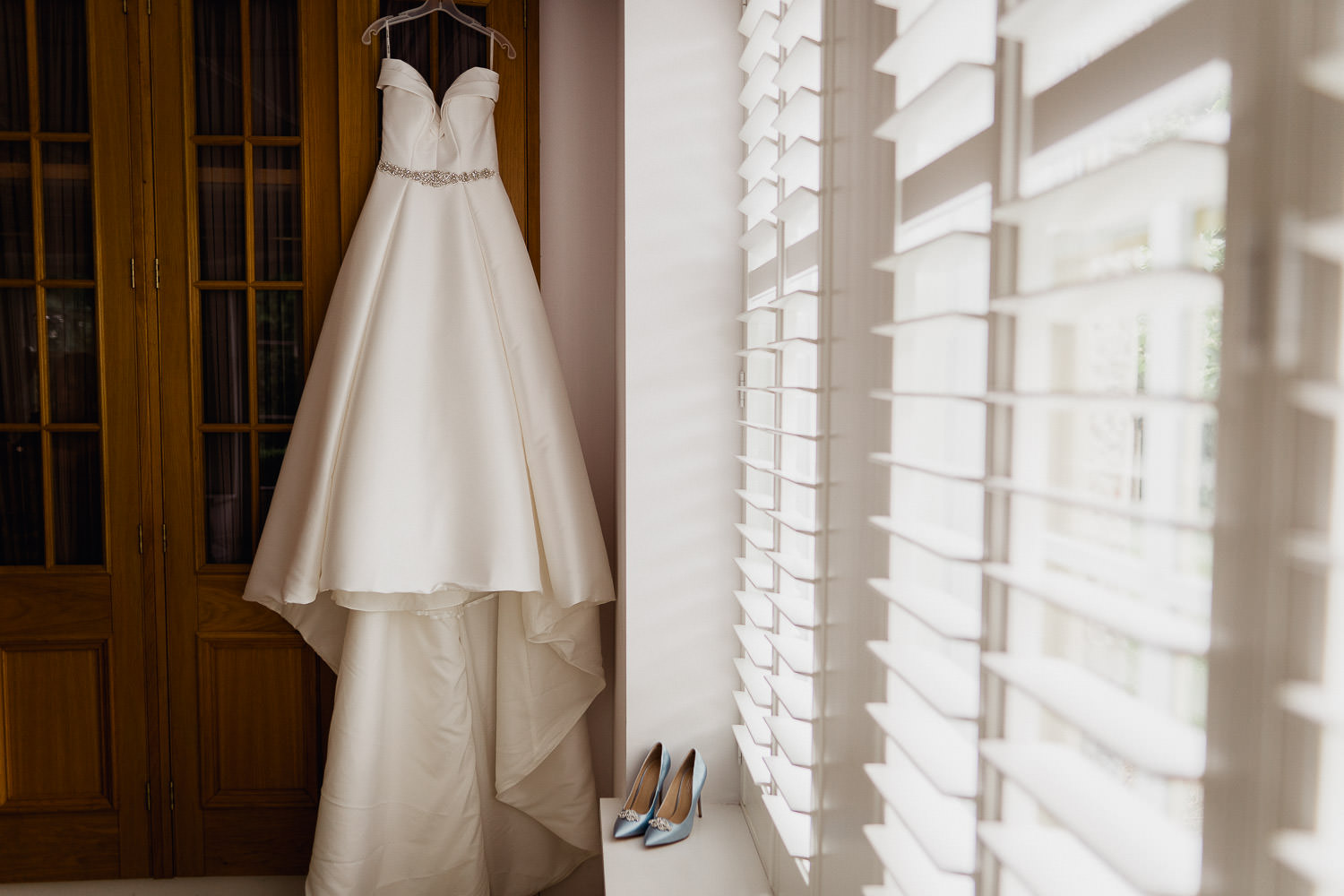 wedding dress and wedding shoes in window light