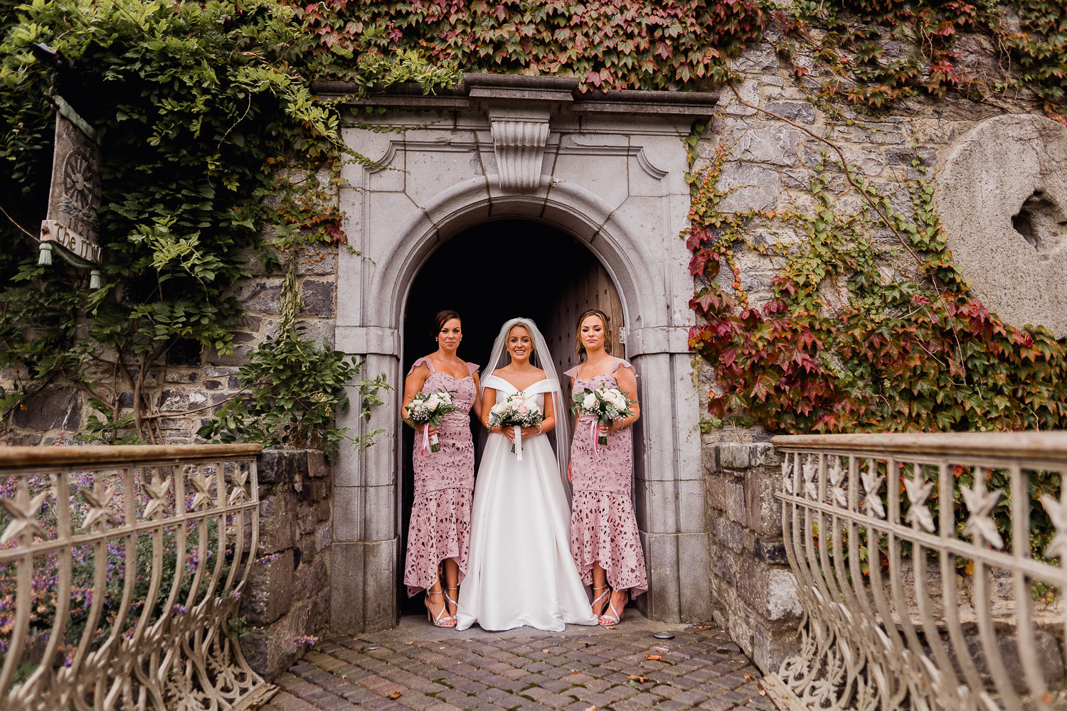 bride and bridesmaids standing in the doorway at Cliff at Lyons