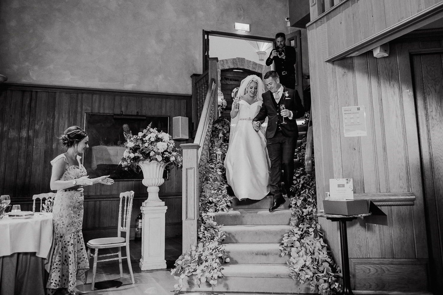 bride and groom walking down a stair case