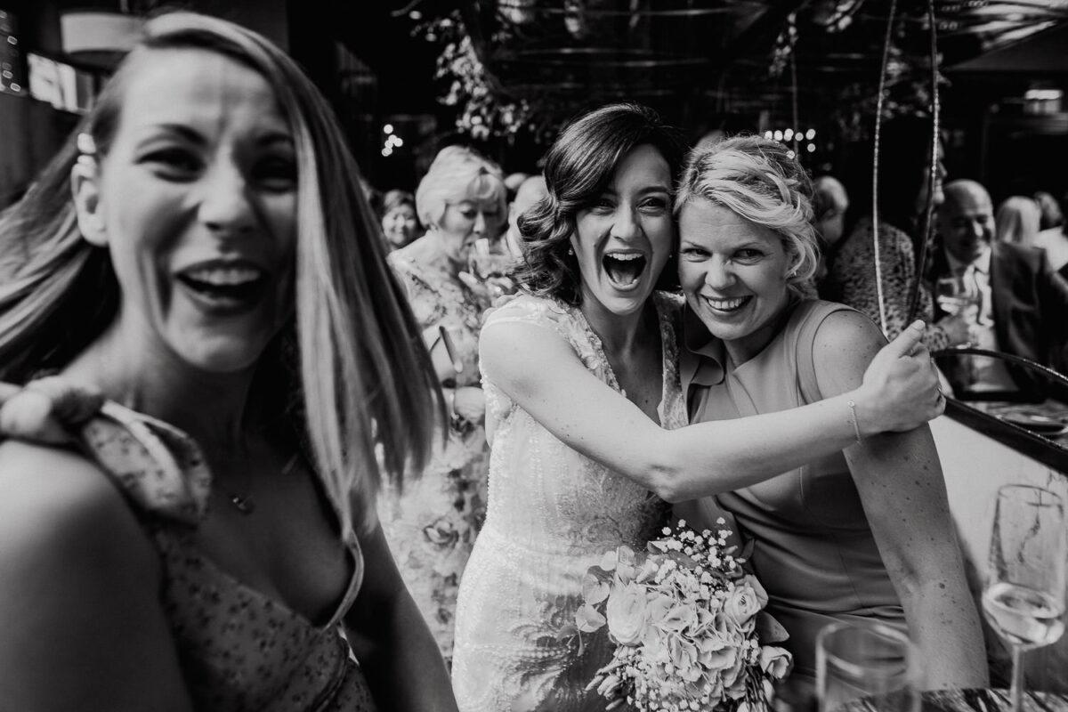 bride hugging wedding guests