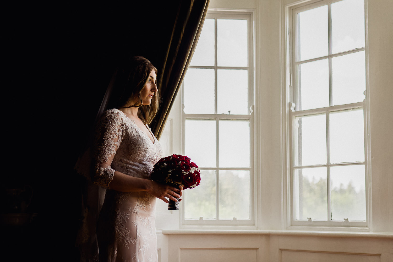bride standing in window light at Kinnitty Castle