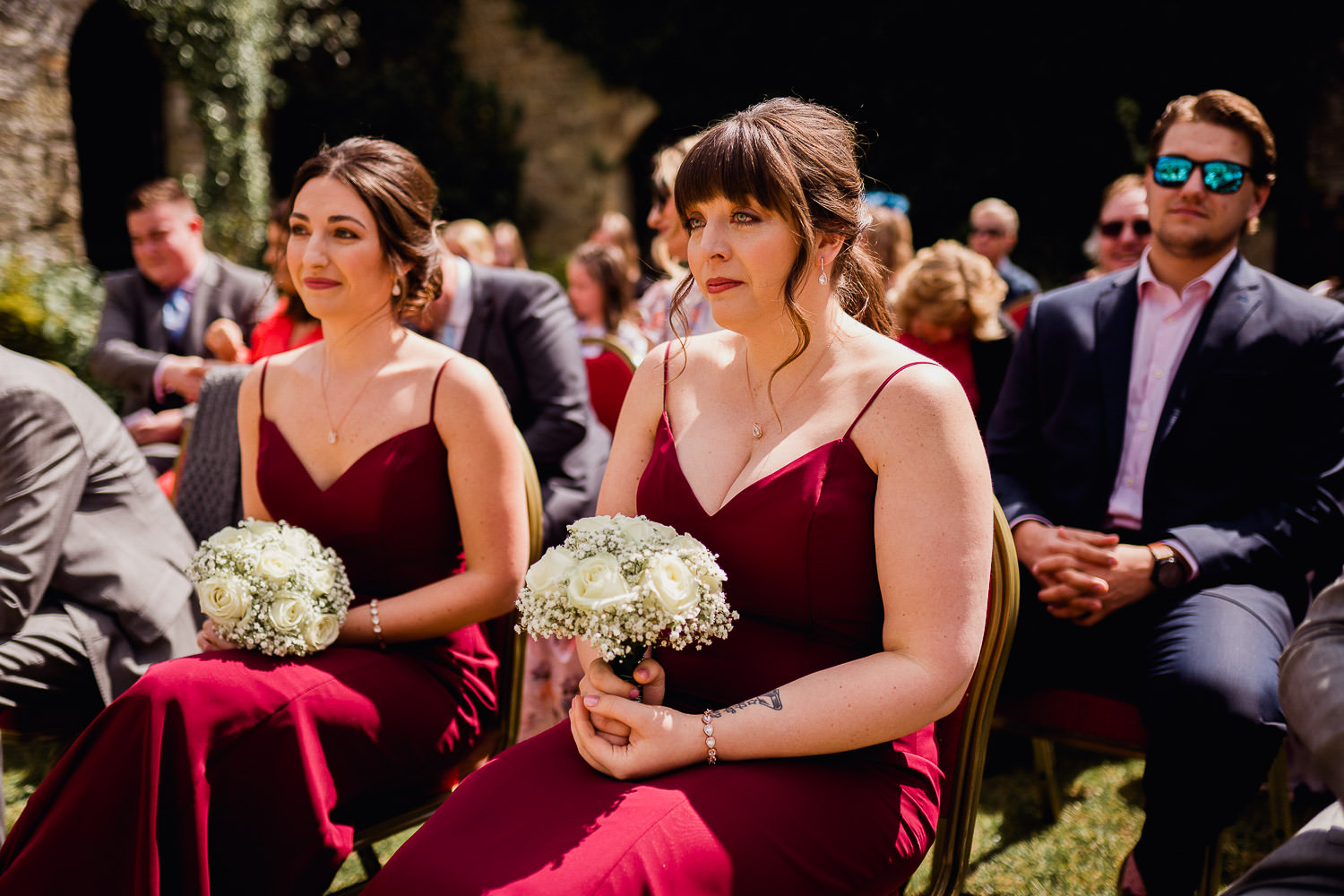 bridesmaid hold flowers during wedding ceremony at Kinnitty Castle