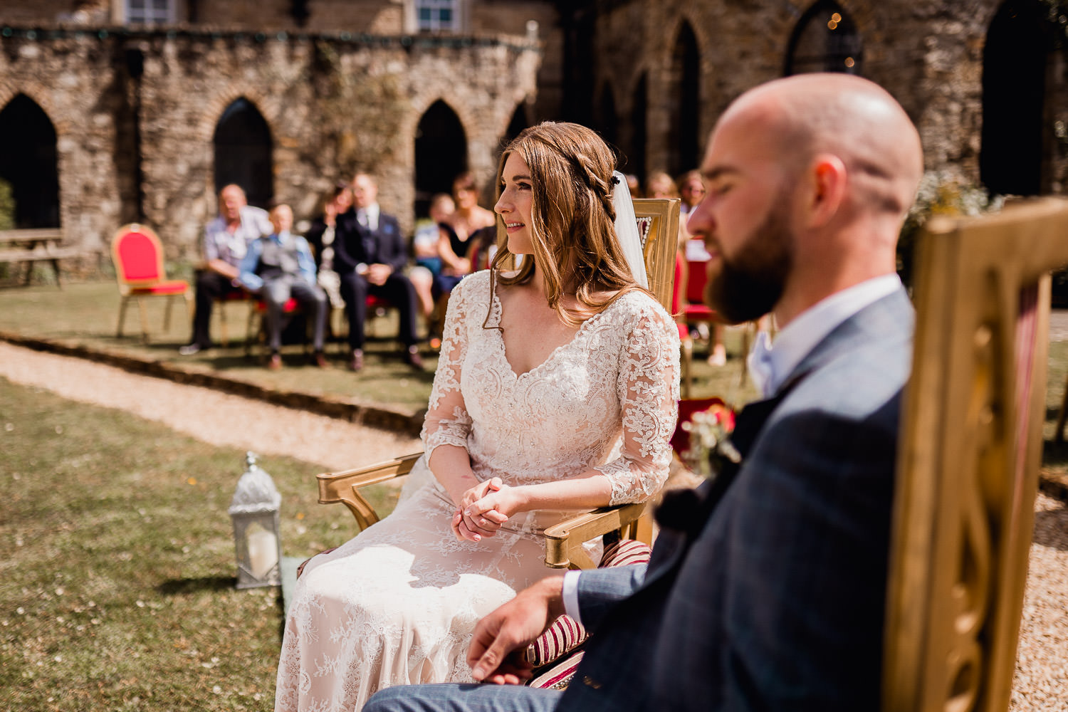 bride and groom sitting beside each other during wedding ceremony