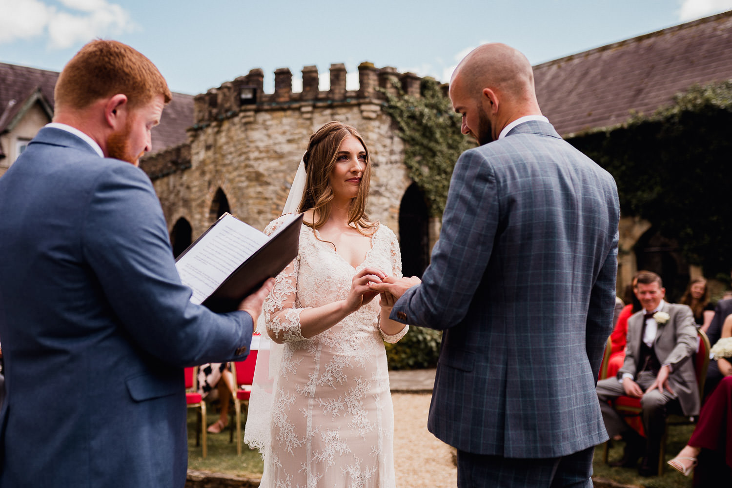 bride and groom exchange vows during wedding ceremony