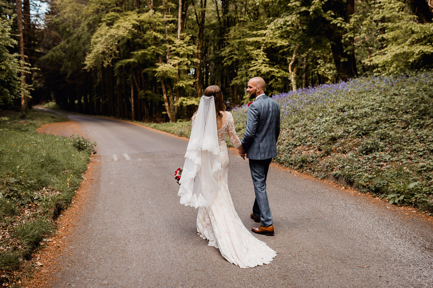 bride and groom walking down the driveway holding hands at Kinnitty castle